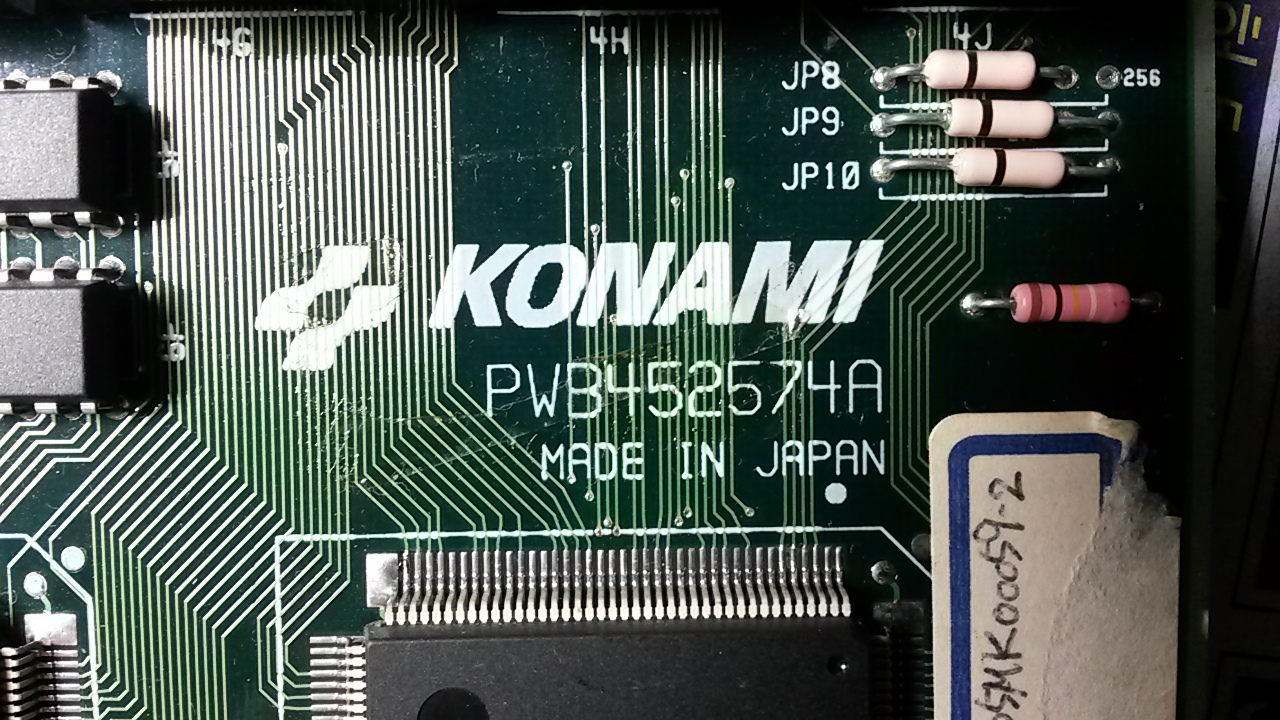A KONAMI ARCADE GAME PCB WITH 2212P003 - 0516..